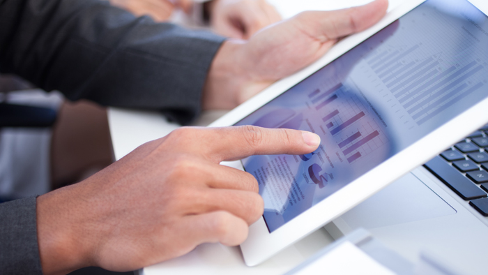 Person looking at analytics on a tablet